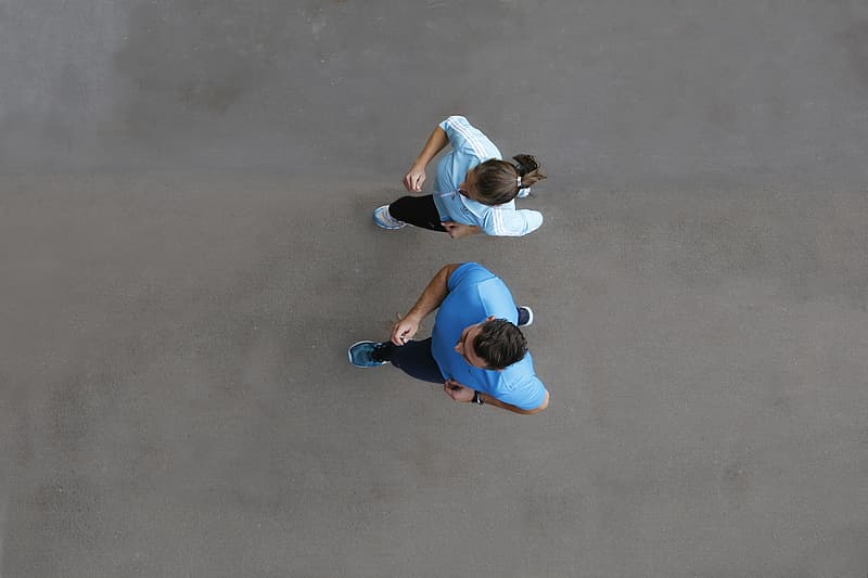 Two woman and man in blue shirts running photo