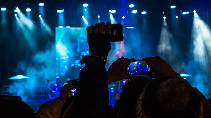 Group of people holding smartphones watching concert