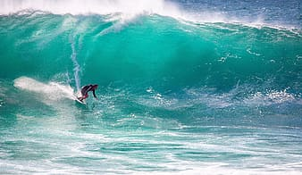 Person doing surfing during daytime