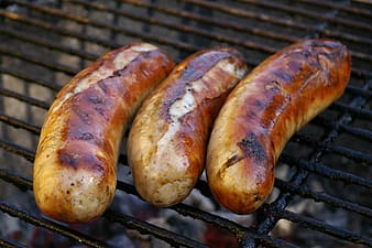 Grilled sausage on charcoal grill