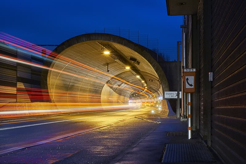 Timelapse photography of speeding lights under road tunnel during nighttime