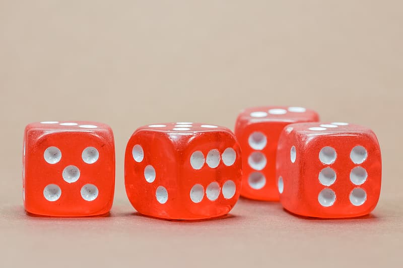 Four red-and-white dices