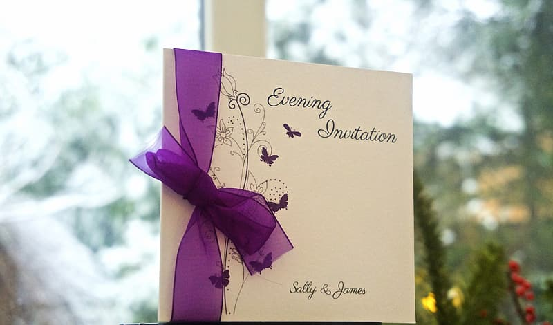 Selective focus photography of white evening invitation