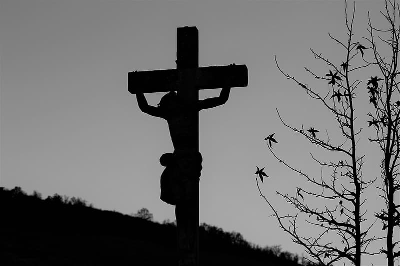 Grayscale photo of crucified person