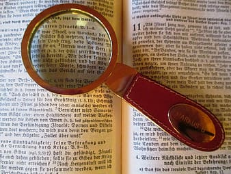 Brown magnifying glass on book