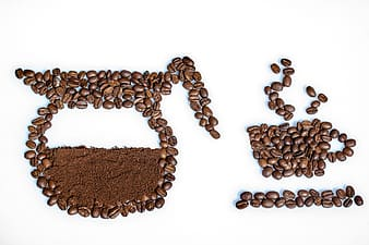 Photo of coffee beans and powder formed to coffee pot and cup