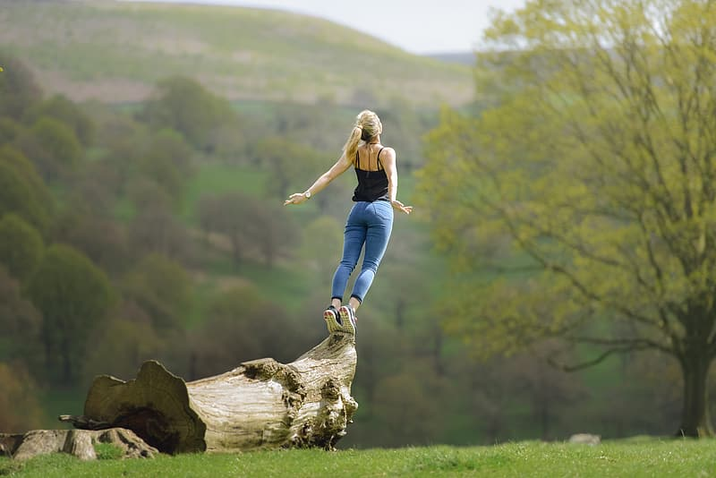 Woman standing on brown wood at daytime