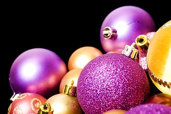 Pink and gold baubles on black background