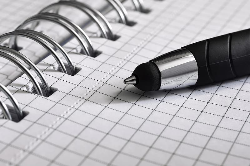 Black and gray pen on graphing notebook