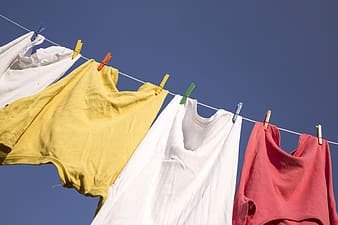 Four clothes hanged on wire