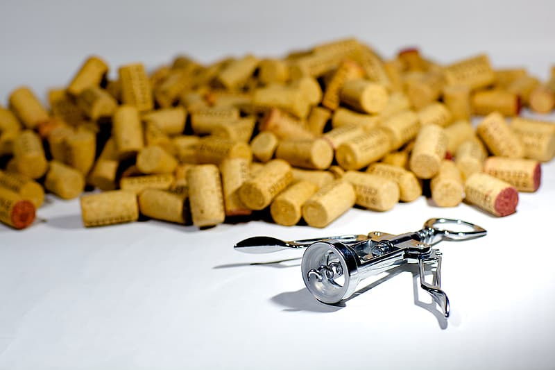 Brown cork lot with gray stainless steel cork opener