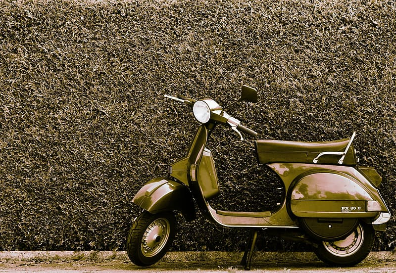 Yellow and black motor scooter on brown and black ground