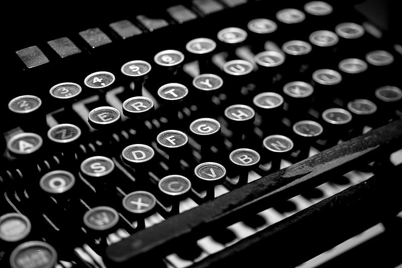 Grayscale photo of typewriter