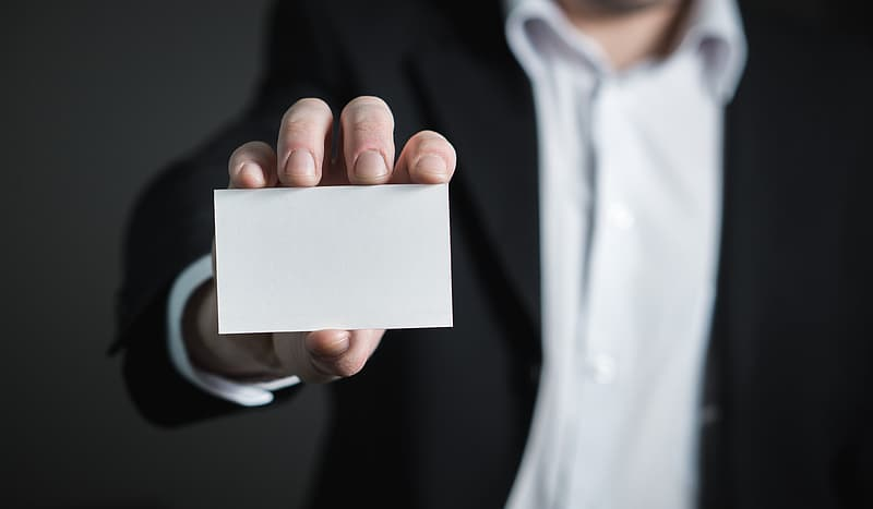 Person holding white labeled box