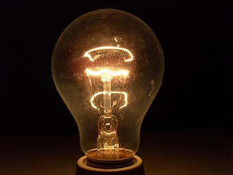 Closeup photography of light bulb turned on