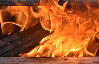 Fire on brown wooden plank