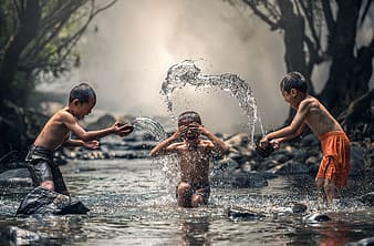 Children playing on body of water