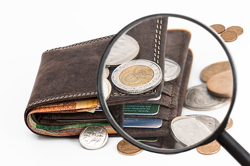 Black magnifying glass and brown leather bi-fold wallet