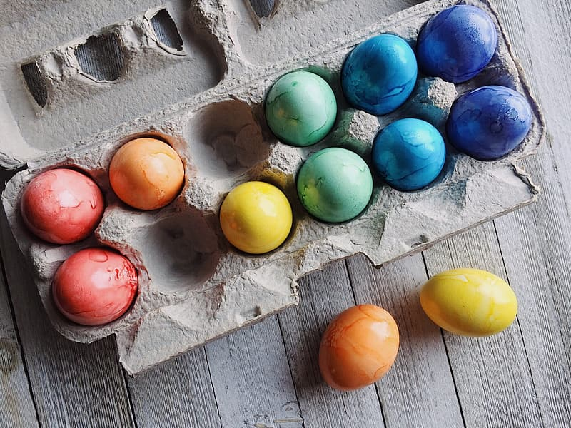Assorted-color eggs in tray