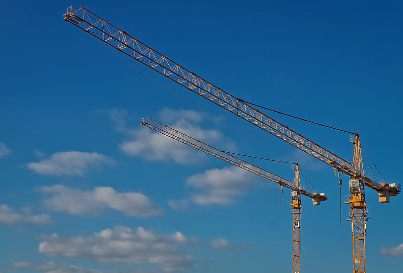 Two crane tower under clear blue sky