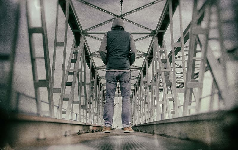Man standing on bridge