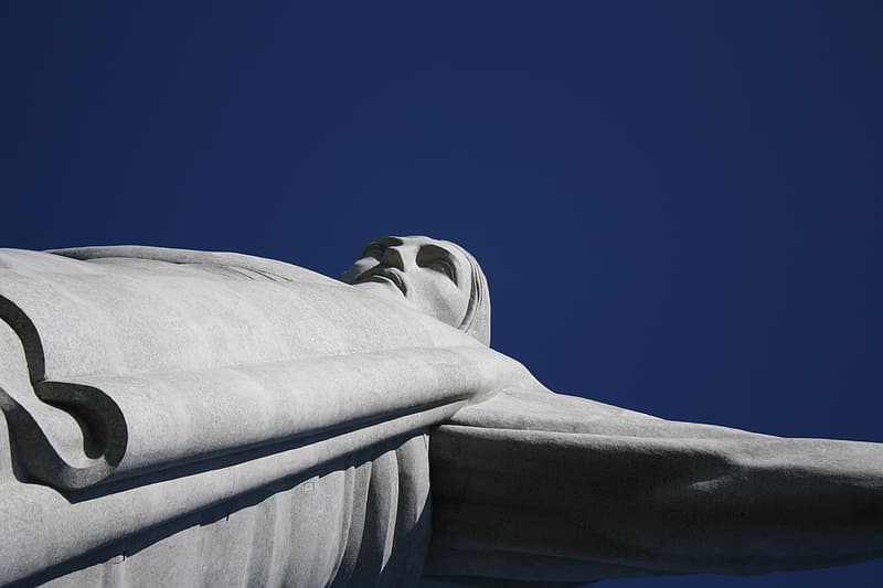 Low angle photography of Christ the Redeemer under blue sky