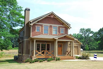 Brown and beige wooden 2-storey house