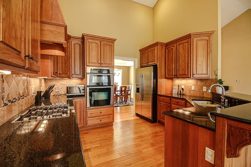 Brown wooden kitchen cabinet and kitchen counter
