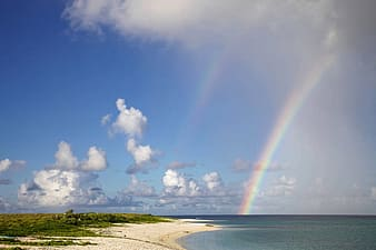 Rainbow and white clouds photo