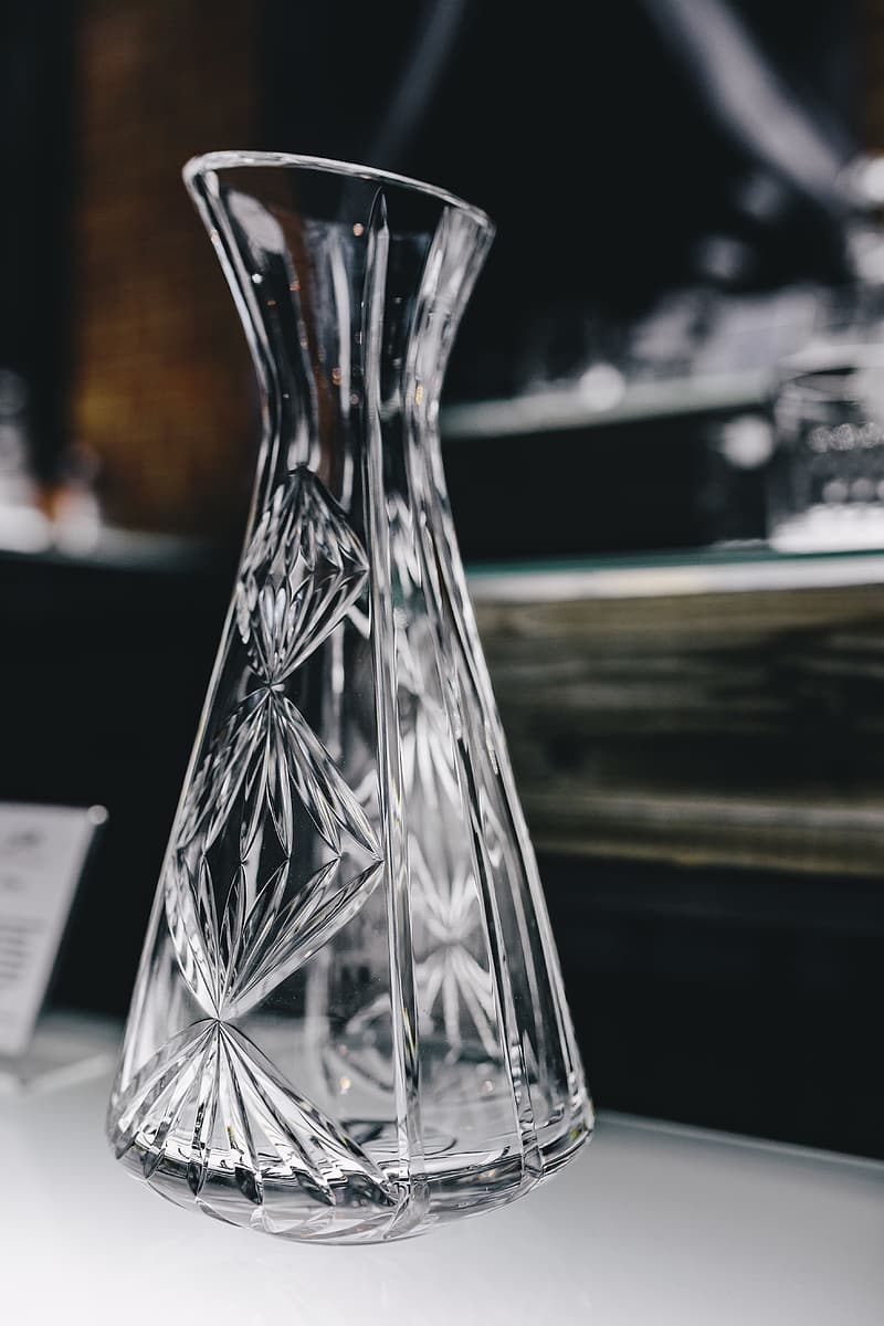 Clear glass vase on table