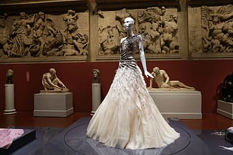 White dress worn on mannequin display in front of the museum