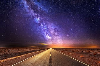 Empty road under starry night