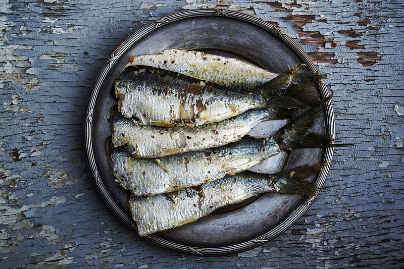 Bunch of cooked fishes on gray plate