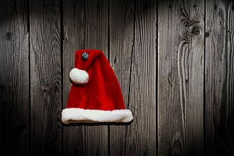 Red santa hat on top of gray wood