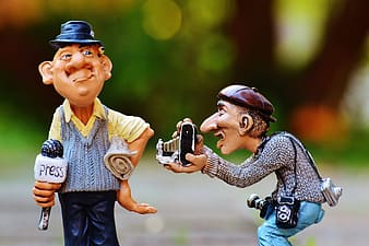 Two male camera man and newscaster figurines