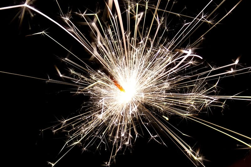 Lighted fireworks at night