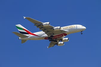 Emirates plane flying