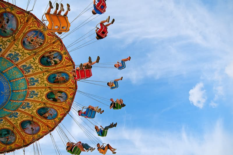 Time lapse photography of circus rides during daytime