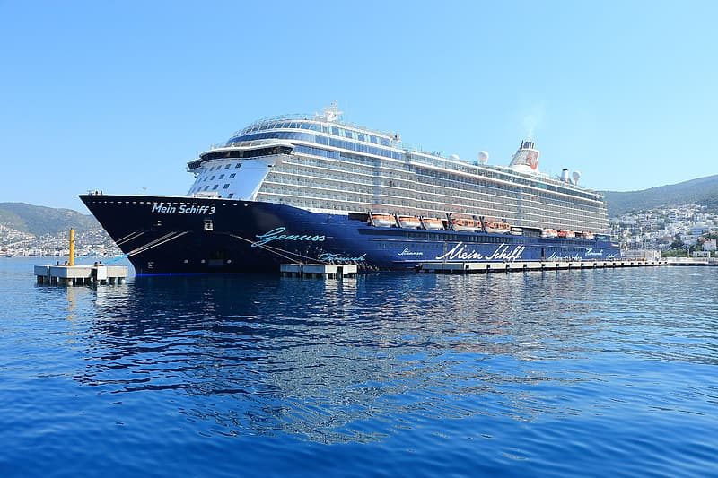 Blue cruise ship on body of water