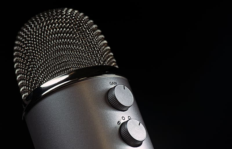 Gray condenser microphone with black background