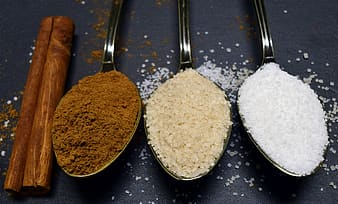Different colored powders on spoons