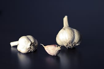 Bulbs and clove of garlic