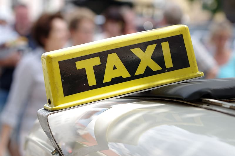 Yellow and black taxi sign