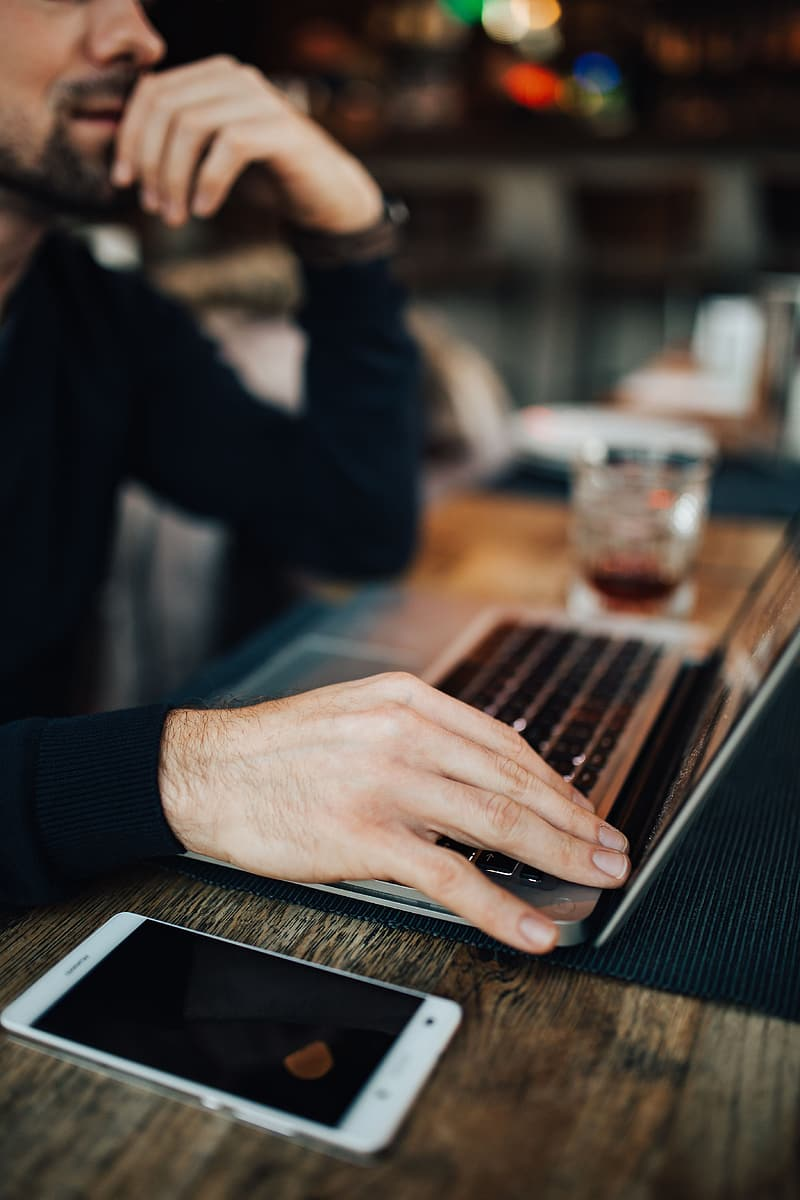 Young Entrepreneur Working from a Modern Cafe
