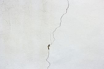 Cracked wall graphic wallpaper