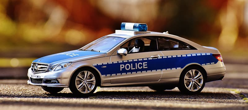 Close-up photo of blue and gray police vehicle toy