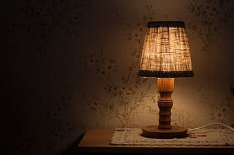 Brown table lamp turned on on table