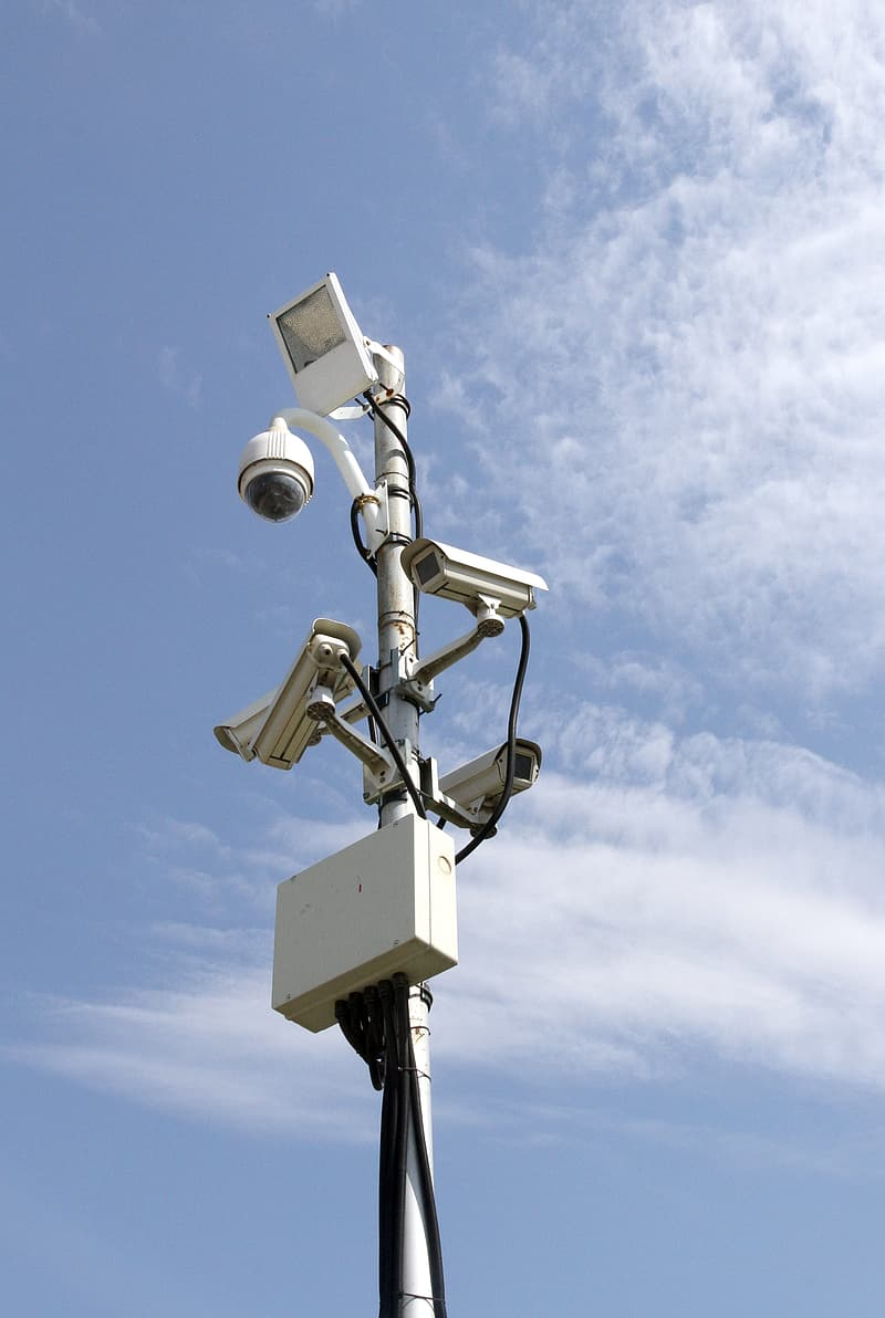 Security camera post with light