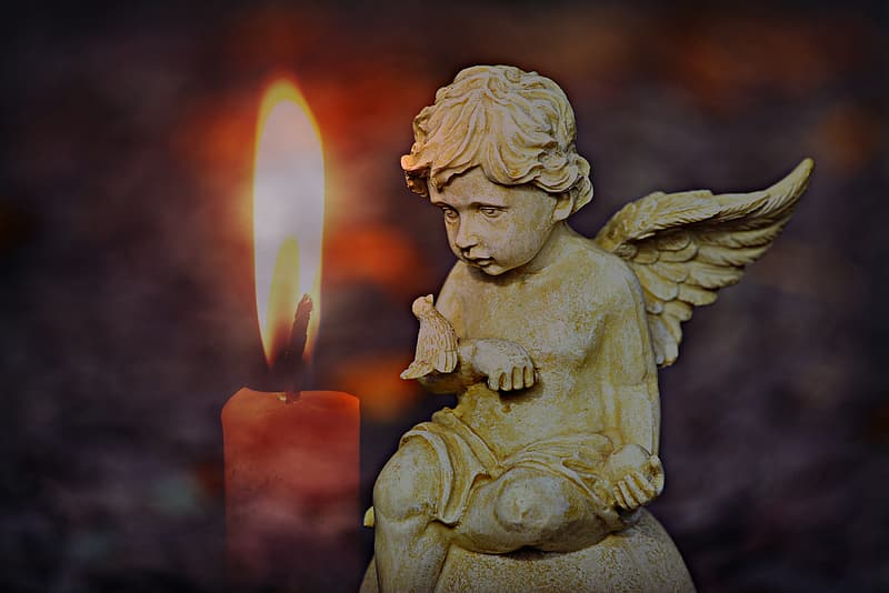 Angel holding candle concrete statue