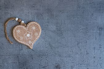 Brown and white wooden floral heart pendant